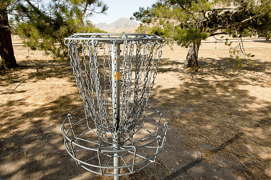SLIP A DISC :  The SLO Throwers, a local disc-golf club, has been instrumental in setting up disc golf courses around San Luis Obispo County, including this one at Laguna Lake, - PHOTO BY STEVE E. MILLER