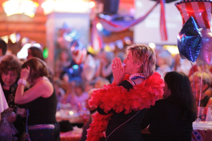 INAUGURAL BALL :  Cynthia Hostetter celebrates a moment shown on the big screen at the ball. - PHOTO BY STEVE E. MILLER