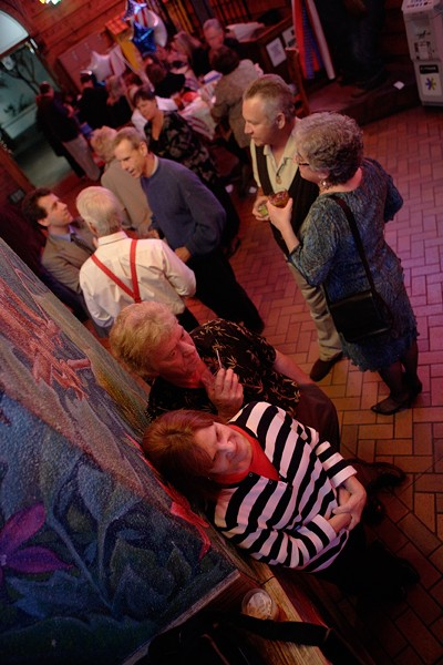 INAUGURAL BALL :  Marylee Rich and Barry Bailey quietly watch the TV at the ball. - PHOTO BY STEVE E MILLER