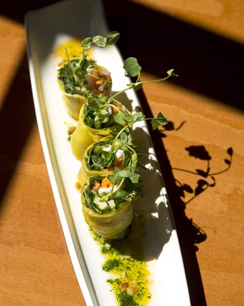 OPTIONS FOR EVERYONE :  Chef Shawn Behrens wants everyone to be able to eat at Luna Red, so his menu has notations to show which food items are available as gluten free or vegan or both. Pictured here: veggie stuffed coconut milk crepes with a chili lime sauce. - PHOTO BY STEVE E. MILLER