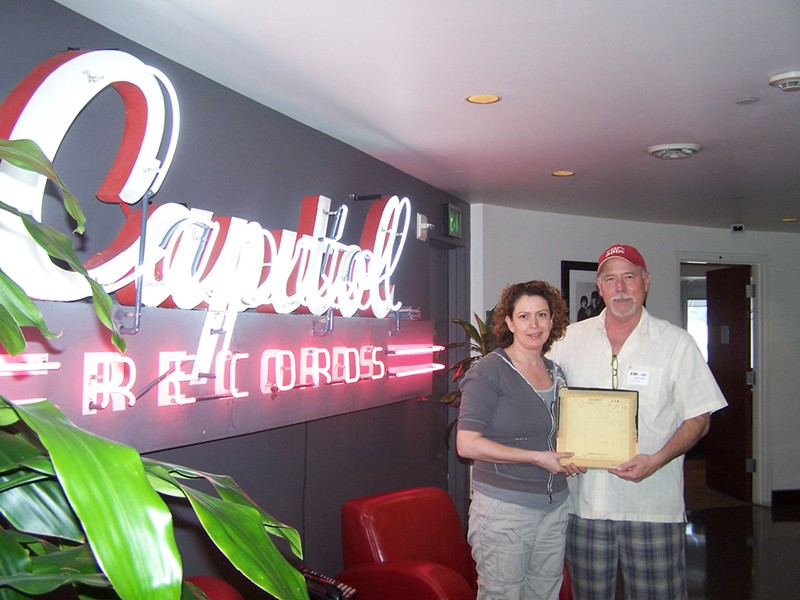 A DONE DEAL :  Capitol/EMI executive Jane Ventom (left) presented Lance - Robison with a check in the Capitol Tower in Hollywood, money Robison used to record his album with the same producer Brian Wilson's used since the '80s. - PHOTO COURTESY OF LANCE ROBISON