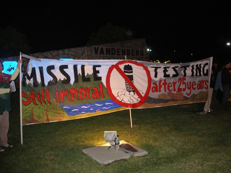 TAKING A STAND :  Dennis Apel, McGregory Eddy, and Father Steve Kelly were arrested during a protest against missile testing such as the one pictured. - PHOTO BY NICHOLAS WALTER