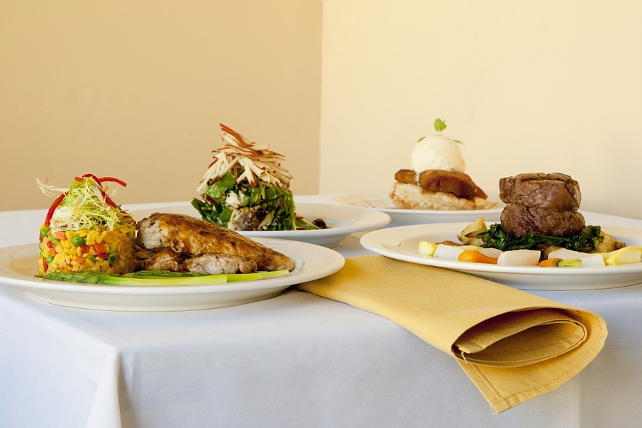 CROSS COUNTRIES :  What do you get when you mix Cuban and Italian cuisine? How about (left to right) arroz con pollo a la Cubana, compressed Manchego salad, apple tart, and filet mignon? - PHOTO BY STEVE E. MILLER