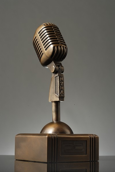 "IN IT TO WIN IT! :  Performers will take home these custom Newtie Awards cast from ""Peace Bronze,"" metal reclaimed from decommissioned weapons systems, and cast by Genesis Bronze. - PHOTO BY STEVE E. MILLER"
