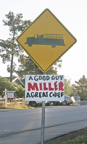 SIGNS OF SUPPORT :  Cambria residents are set to protest the firing of popular former fire chief Mark Miller at the April 28 CSD Board of Directors meeting. - PHOTO BY MATT FOUNTAIN