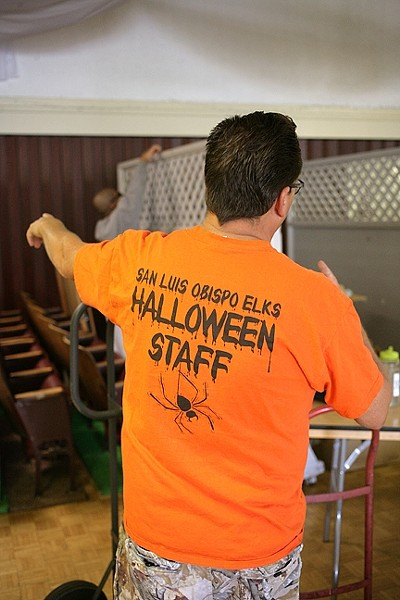 IT'S TED!:  Ted directs his crew of Elks Lodge volunteers as they create a fun and safe alternative to Trick or Treating. - PHOTO BY GLEN STARKEY