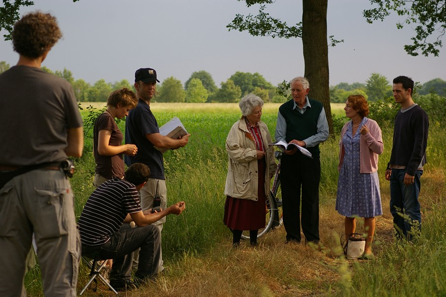 ON THE SET :  Paul Cotter (wearing the baseball hat) spent 28 days in a German village filming Bomber - PHOTO COURTESY OF PAUL COTTER