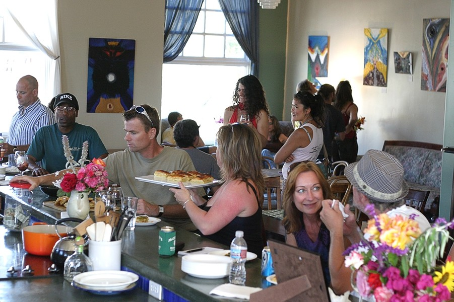 FACES IN THE CROWD :  About 40 or 50 people gathered throughout the afternoon for Linda Castellon's art opening at Sustenance Cooking Studio. - PHOTO BY GLEN STARKEY
