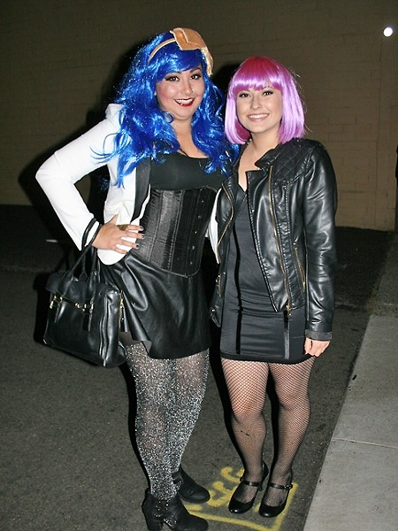 PARTY GOERS:  From left, Theresa Michelle Triplett and Cameron Ruiz break out the neon wigs and gear up to dance 'The Time Warp.' - PHOTO BY HAYLEY THOMAS