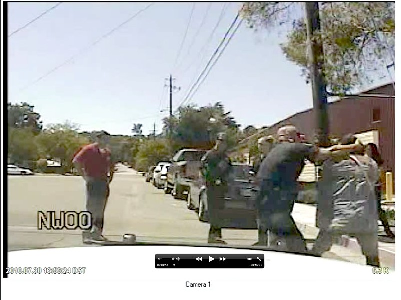 Still from video of arrest from patrol car. Note: There is no audio for the first 30 seconds of the video.