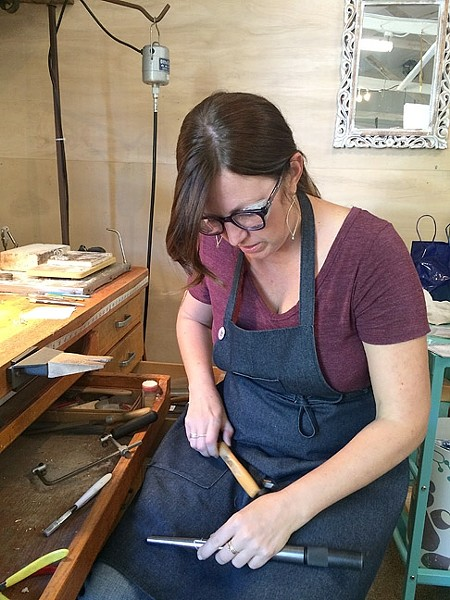 SOLDERING AWAY:  Jeweler Kerry Long cuts, solders, and hammers away at her workspace at The Bunker in SLO as she creates one-of-a-kind metal jewelry. - PHOTO COURTESY OF KERRY LONG