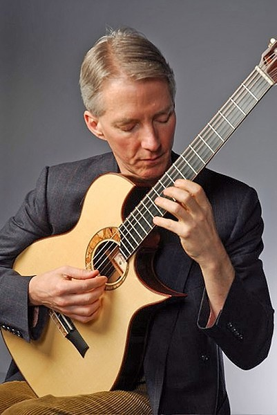 JAZZ MASTER :  Jazz guitar great John Stowell plays a solo dinner show in the cellar at Novo on Feb. 21. - PHOTO BY MARK LAMOREAUX