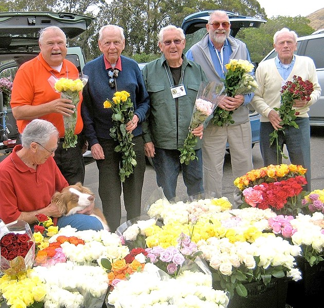 WEEKLY RITUAL:  The Flower Power team members are (from left to right) Norm Mayer, Steve Bennett, Bob Wiese, Eugene Juel, Doug Schuur, and Leo Dumouchelle (absent member: Will Perry). Every Wednesday, Bennett picks up 1,400 surplus flowers from growers in Nipomo who donate them, which the men distribute to 25 assisted living or hospice centers in SLO County. - PHOTO COURTESY OF STEVE BENNETT
