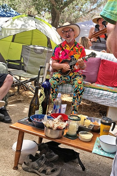 CRAVEN IN THE HOUSE:  Festival emcee Joe Craven made an impromptu visit to our camp's Mad Hatter tea party and laid down some jams. - PHOTO BY GLEN STARKEY