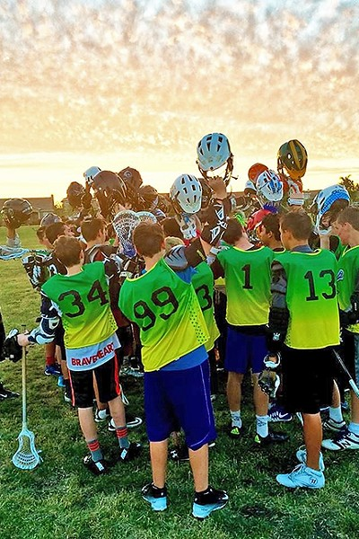 GAME OVER:  805 Lax players huddle up after a game. Spring season starts in March and the club is hosting a free lacrosse clinic on Jan. 28 at Bishop Peak Elementary School in SLO. - PHOTO COURTESY OF 805 LAX