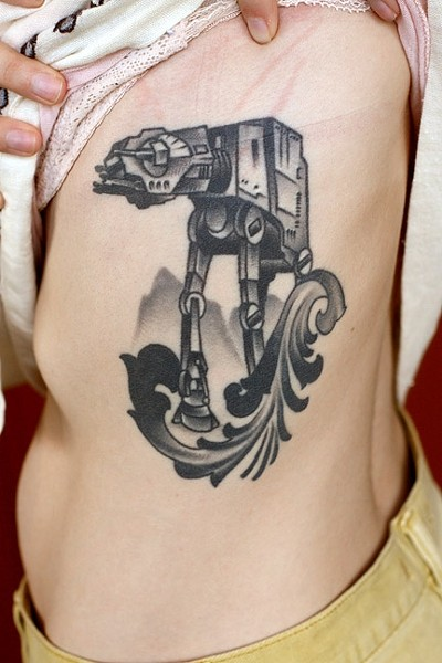 THAT TORSO THO:  The side panel/rib area is a popular go-to spot for tattoos that can also be concealed. Star Wars AT-AT walker tattoo art by Jake Schroeder. - PHOTO COURTESY OF JAKE SCHROEDER