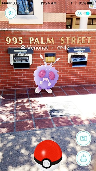 STUDYING UP:  A Venonat lurks near the book return slot at the public library in downtown SLO. - SCREENSHOT BY KATRINA BORGES
