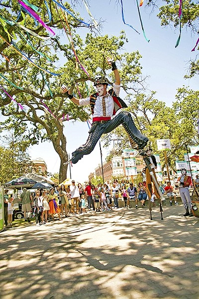 DAY OF WONDER:  A stilt walker leaps in the air at the downtown park in Paso Robles as part of Paso ArtsFest last year. - PHOTO COURTESY OF ALLYSON MAGDA