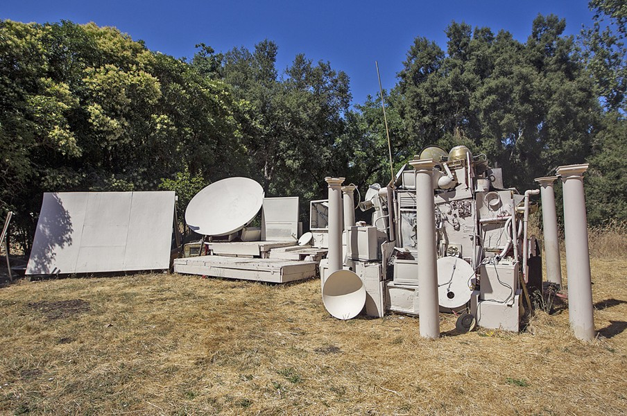 "ROAD LESS TRAVELED Twenty-something artist and musician Dr. Isapony XD built what he calls his ""time machine""—all sourced from discarded electronics and building materials—in the backyard of his Atascadero rental, where he screens movies and hosts concerts. - PHOTO BY JAYSON MELLOM"