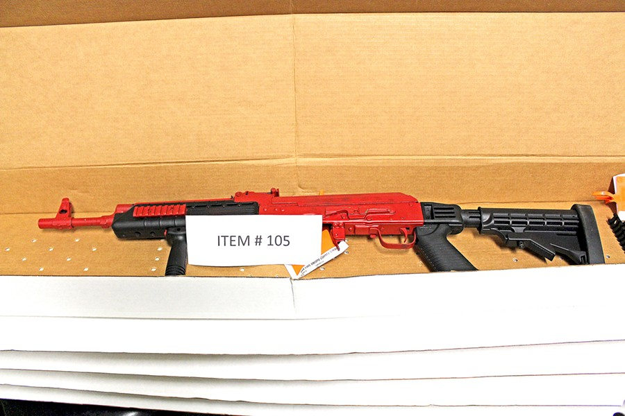 HARDWARE Investigators recovered seven firearms, including this custom-painted AK-47, in connection with the cocaine trafficking case. - PHOTO COURTESY OF SLO COUNTY SHERIFF'S OFFICE