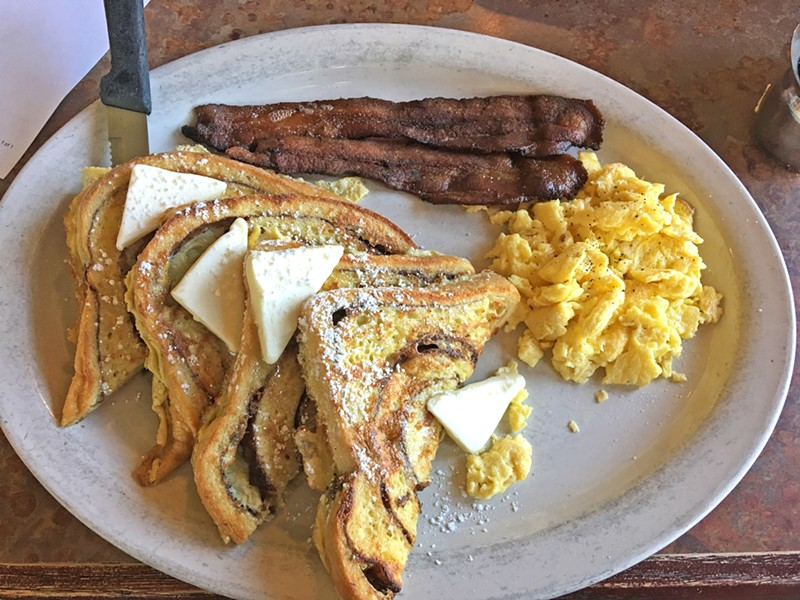 BREAKFAST OF CHAMPS French toast, bacon, and eggs will run you $10 at Charlie's Place. You can add bottomless mimosas to your Sunday brunch for $14. - PHOTO BY PETER JOHNSON
