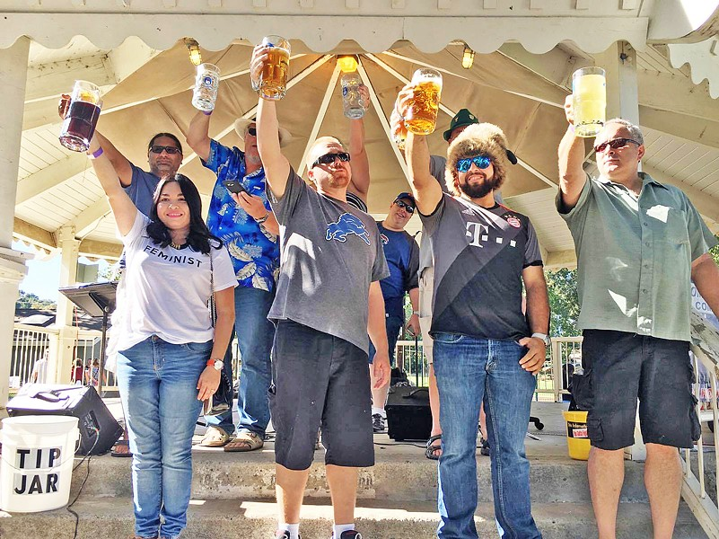 RAISE A GLASS! Stein hoisting contestants show off their arm strength for the crowd at Oktoberfest in Templeton. The rules are simple: take a full stein, lock your elbow, and hold it at shoulder height for as long as you can! - PHOTO BY SINÉAD SCHOUTEN