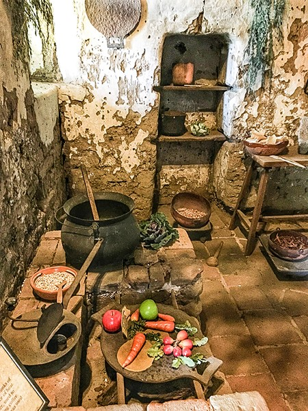 COCINA This kitchen, staged by mission staff members as part of a self-guided tour, no doubt looks as it did in 1848, when the 10 souls were snuffed out on a cold December night. - PHOTO BY GLEN STARKEY