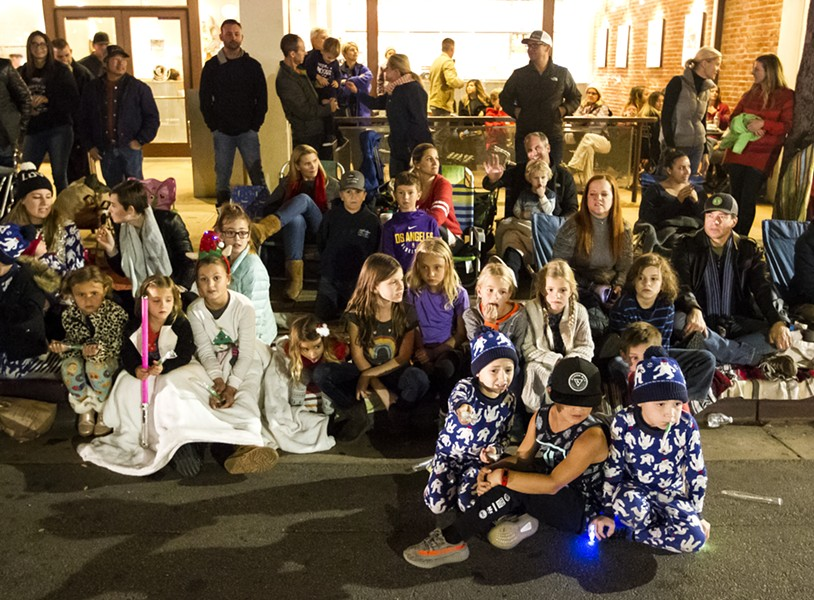 RAPT AUDIENCE Kids especially marveled at this year's parade lining the entire nine-block parade route. - PHOTO BY JAYSON MELLOM