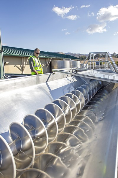 GRAPE MACHINE Technology is becoming part of the harvesting process at wineries in SLO County. - PHOTO BY JAYSON MELLOM