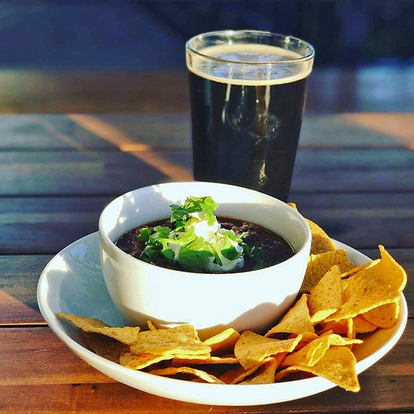 LOCAL SNACK ATTACK Spicy three bean chili served hot at 7Sisters Brewing Company satisfies on chilly January nights. You'll also want to try their extensive grilled cheese selection, which ranges from a simple kids version to one featuring ciabatta and pancetta. As always, all ingredients are sourced locally from in and around SLO County. - PHOTO COURTESY OF 7SISTERS BREWING CO.