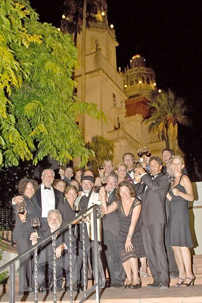 CHEERS Archie McLaren (center) poses with a group of sommeliers in 2006 at the Central Coast Wine Classic's dinner at Hearst Castle. - PHOTO COURTESY OF HISTORY CENTER OF SLO COUNTY