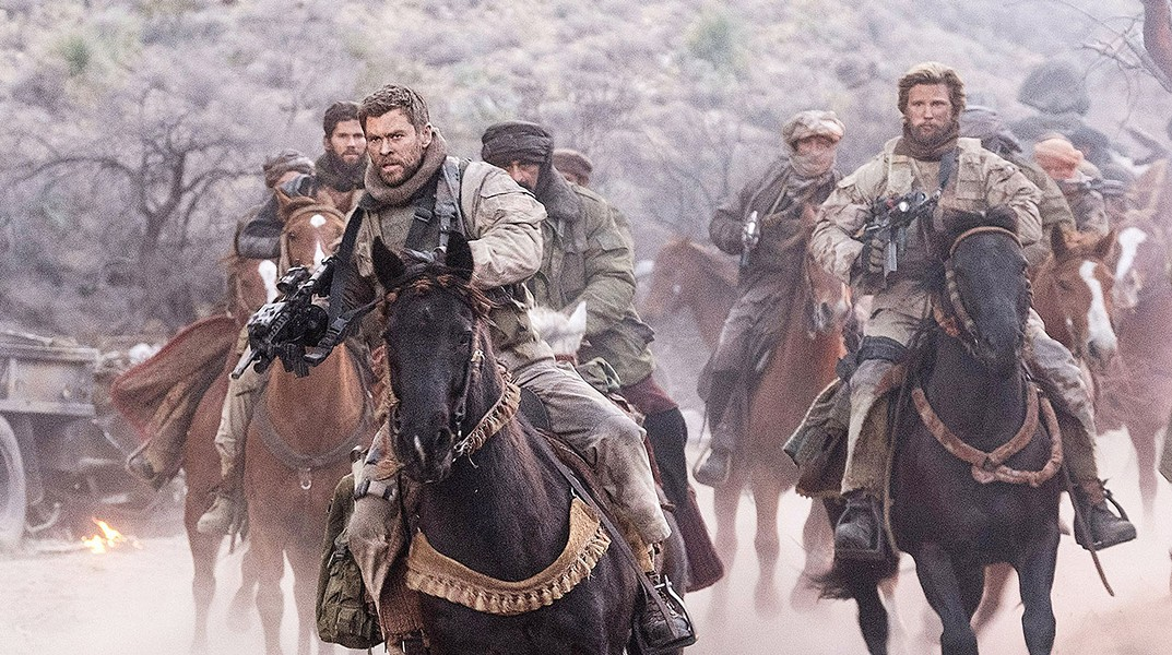 HORSE SOLDIERS In the aftermath of 9/11, Capt. Mitch Nelson (Chris Hemsworth) leads a U.S. Special Forces team into Afghanistan on a dangerous mission in 12 Strong. - PHOTO COURTESY OF WARNER BROS. PICTURES