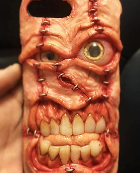 "CREEPY CRAWLY Grover Beach artist Joe Rowles crafts functional pieces like this cellphone case that he classifies as ""grotesque art."" - PHOTO COURTESY OF JOE ROWLES"