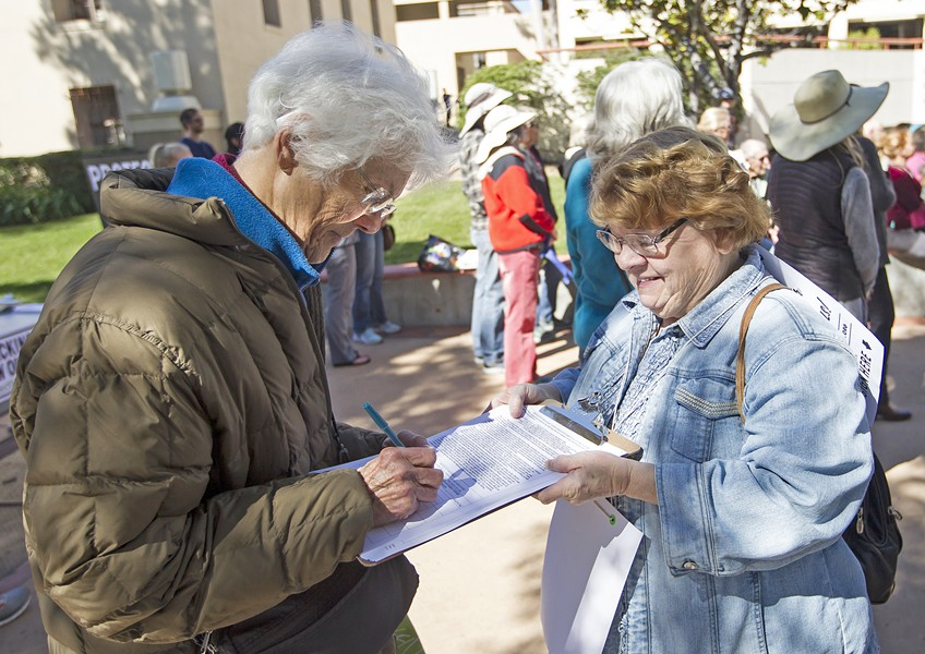 BAN IT Petitioners used U.S. Rep. Salud Carbajal's Feb. 13 press conference against offshore oil drilling as the place to kick off their ballot initiative to ban new oil wells, hydraulic fracturing, and other intense oil extraction techniques. - PHOTO BY JAYSON MELLOM