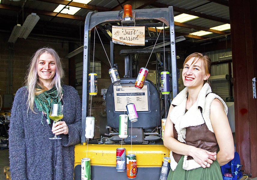 "MEET THE BROADS From left, Morgan Murphy and Maggie Przybylski of Two Broads Ciderworks are making dry, crisp hard ciders in an industrial neighborhood near Broad Street in San Luis Obispo. For the co-founders, working together is a dream come true (note the ""just married"" sign hanging from their shared forklift, adorned with favorite cider cans). - PHOTO BY JAYSON MELLOM"