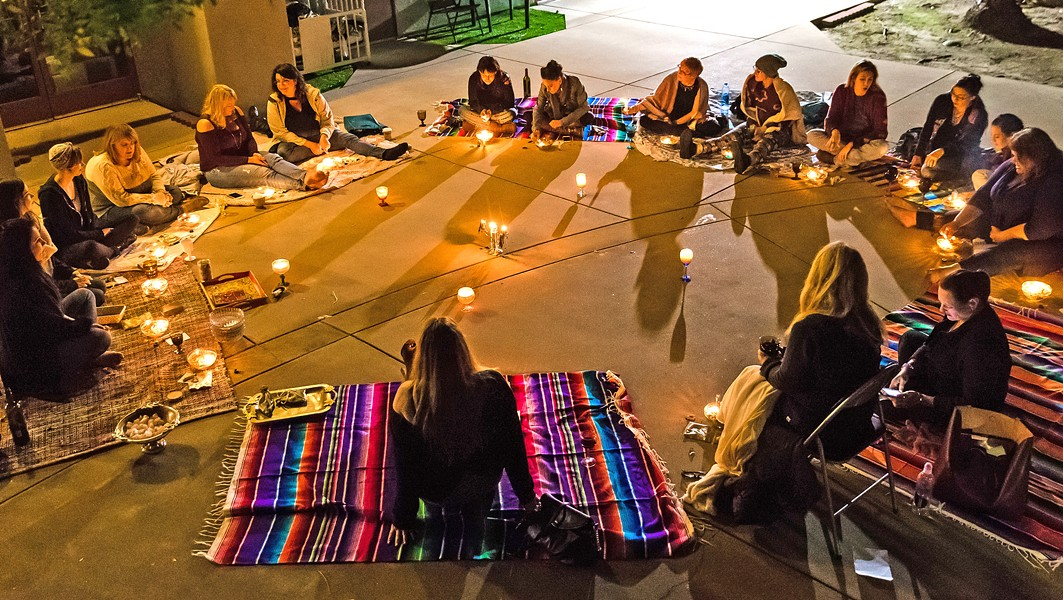 CIRCLE OF SISTERHOOD Women gather behind the Tamed Wild Apothecary in Arroyo Grande to welcome the full moon, set intentions, and enjoy - PHOTO BY JAYSON MELLOM