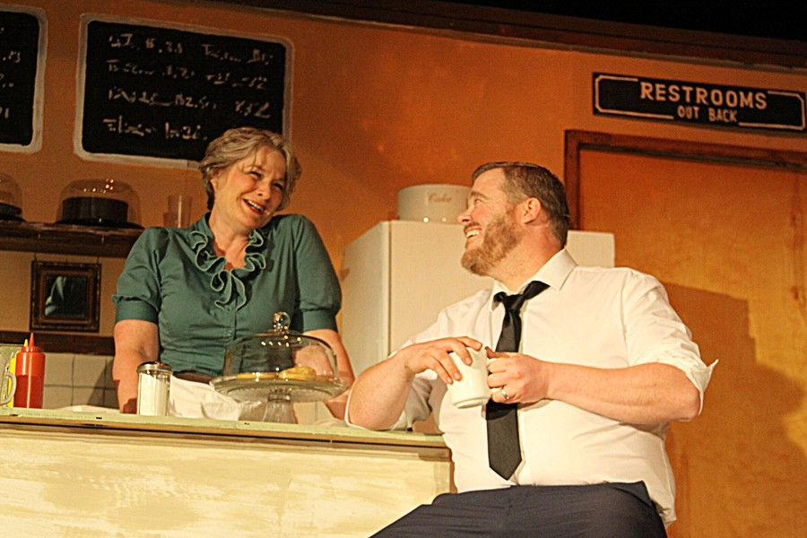 IT'S COLD OUTSIDE A storm that leaves bus riders and its driver stranded at a tiny diner gives an opportunity for love to bloom between Grace (Dawn Doherty) and Carl (Mark Klassen). - PHOTO COURTESY OF THE CAMBRIA CENTER FOR THE ARTS