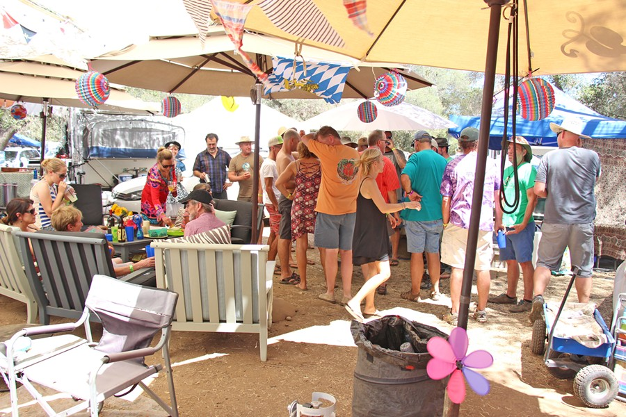 GATHER Camp Happy hosts a big gathering under their sun sails during the heat-of-the-day siesta-fiesta. - PHOTO COURTESY OF DAN KALLAL