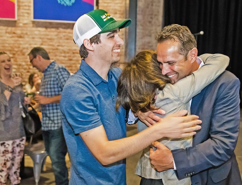 VICTORY SLO County Sheriff Ian Parkinson celebrates with his family after preliminary election results show him winning a third term. Parkinson faced a difficult and acrimonious campaign against his challenger, local private investigator Greg Clayton. - PHOTO BY JAYSON MELLOM