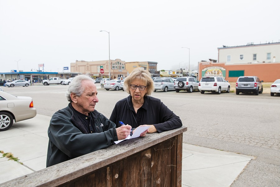 GETTING TO WORK Cayucos Advisory Council members John Carsel and Cheryl Conway are seeking tighter regulations on vacation rentals in Cayucos. The small beach town has the most vacation rental licenses per capita in SLO County. - PHOTO BY JAYSON MELLOM