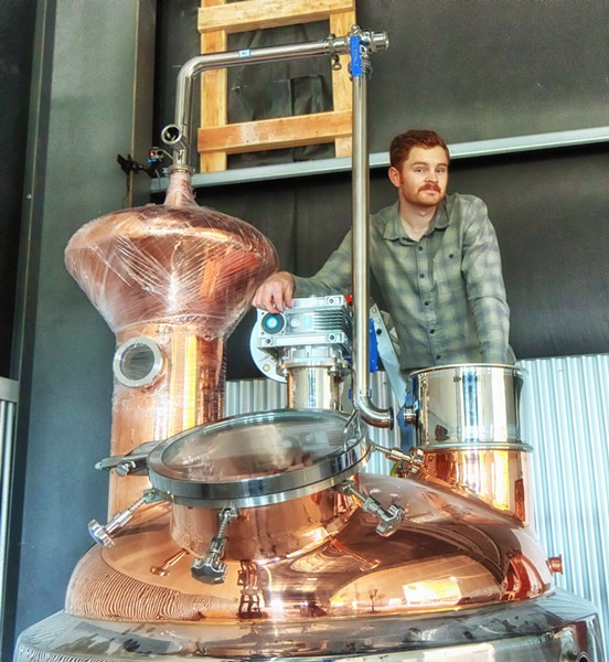 A DREAM, DISTILLED Calwise Distillery Master Distiller Aaron Bergh opened a new, 6,000-square-foot distillery and tasting room in Paso Robles. - PHOTO COURTESY OF CALWISE