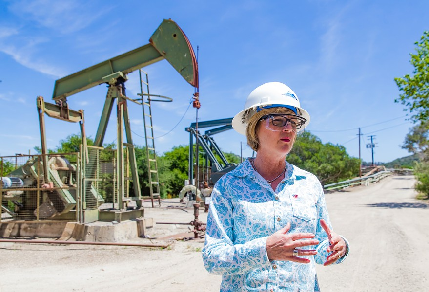DEFENDING HYDROCARBONS Christine Halley, director of environmental safety and hazards for Sentinel Peak Resources, explains the process of oil extraction at the Price Canyon operation. - PHOTO BY JAYSON MELLOM