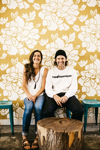 SIGNED Canned Pineapple Co. duo Shelby Lowe and Buddy Norton are based in SLO but are on the road about seven months of the year, painting signs for mom-and-pop shops and corporate businesses alike. - PHOTOS COURTESY OF CANNED PINEAPPLE CO.