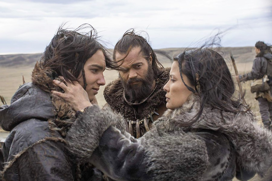 CLAN LIFE Keda (Kodi Smit-McPhee, left) is bid goodbye by his mother, Rho (Natassia Malthe, right), as he leaves on his first hunt with his father, Tau (Jóhannes Haukur Jóhannesson, center). - PHOTO COURTESY OF STUDIO 8