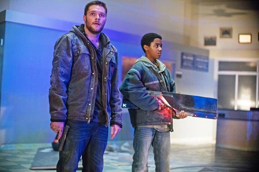 BROTHERS Ex-con Jimmy (Jack Reynor, left) and his adopted brother Eli (Myles Truitt) must protect themselves from criminals, federal agents, and alien soldiers who are after a weapon Eli found, in the sci-fi actioner Kin. - PHOTO COURTESY OF LIONSGATE