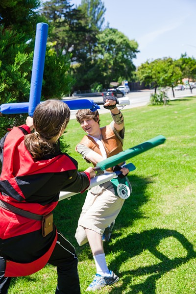 SAY YARP TO LARP Members of the Seven Sleeping Dragons take part in Amtgard, a live action role-playing combat game. - PHOTO BY JAYSON MELLOM