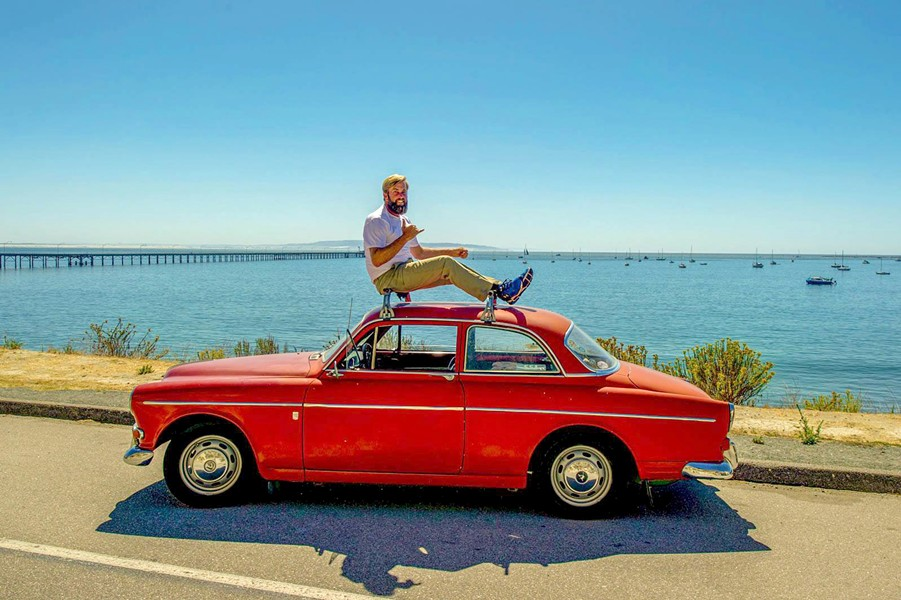 GIVING BACK IN STYLE Ryan Burmaster is president and co-founder of SloRolling, a vintage Volvo group that works on cars and gives back to the community. - PHOTO COURTESY OF SLOROLLING