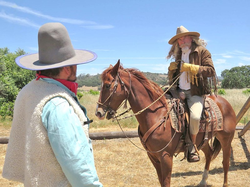 TO THE RESCUE Buffalo Bill (Ted Levine, right) speaks to Sheriff Jesse (Billy Moen) after the missing cows are located. - PHOTO COURTESY OF SEAN MCALPINE