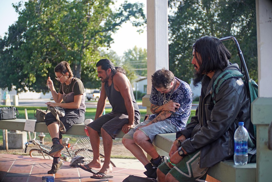 GATHERING Members of SLO's homeless community and others gather at Mitchell Park, where the local chapter of Food Not Bombs offers a meal once a week. - PHOTO COURTESY OF FOOD NOT BOMBS SLO