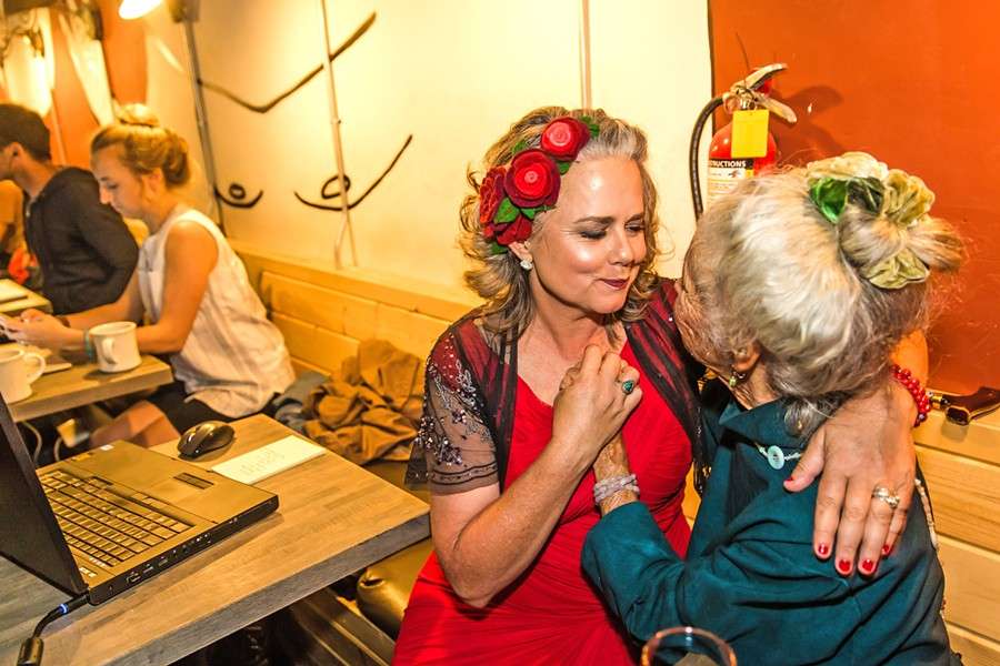 VICTORY San Luis Obispo Mayor Heidi Harmon embraces a supporter at Kreuzberg in downtown SLO on Nov. 6, as election results showed she won a landslide victory over T. Keith Gurnee. - PHOTO BY JAYSON MELLOM